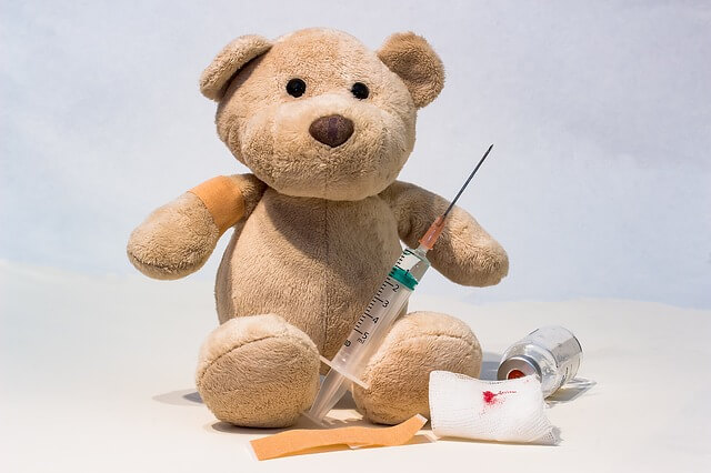 Teddy bear holding needle. How to prevent sharps and needle stick injuries