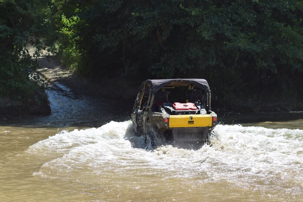 Side by Side Vehicle going through water safety