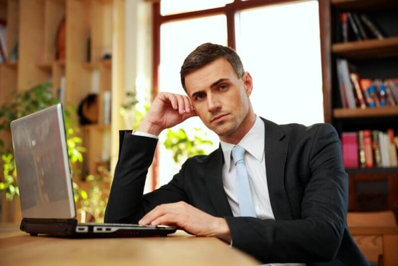 professionally dressed man using laptop image used in changes to safety laws